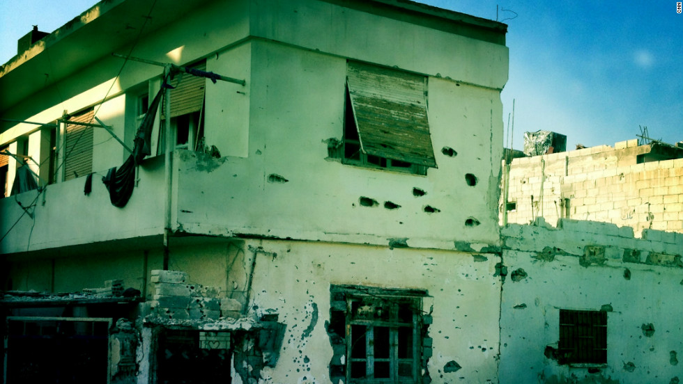 Bullet-scarred walls are pictured in Baba Amr, Homs.