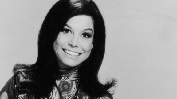circa 1971:  Full-length promotional studio portrait of American actor Mary Tyler Moore sitting in a chair. She wears a peacock feather-patterned blouse.  (Photo by Hulton Archive/Getty Images)