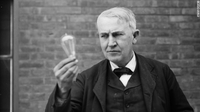 Inventor and physicist Thomas Edison (1847 - 1931) looking at a lightbulb (Photo by Nathan Lazarnick/George Eastman House/Getty Images)