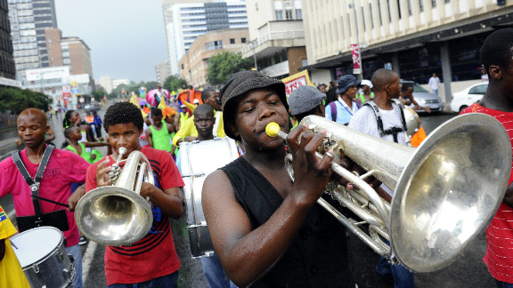 In Johannesburg, musicians and dancers took to the streets for the traditional New Year's Eve carnival.