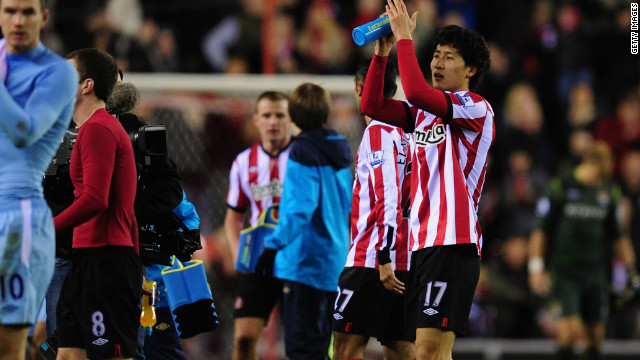 South Korean striker Ji Dong-Won (right) celebrates after Sunderland's dramatic 1-0 home win over Manchester City.