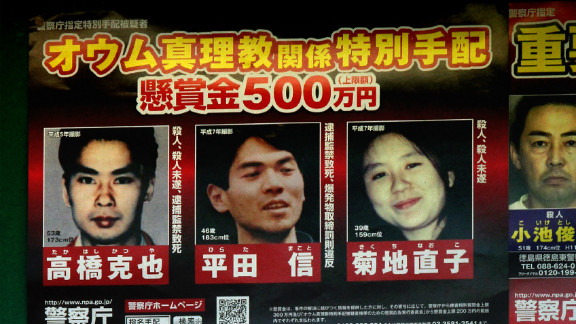 Makoto Hirata (C) a former senior member of the Aum Shinrikyo doomsday cult was arrested after almost 17 years on the run.