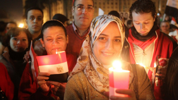 Thousands of Egyptian Muslims and Coptic Christians attend a celebration on New Year's Eve in Tahrir Square in Cairo,  as they remember those killed in the revolution that ended the long reign of President Hosni Mubarak.