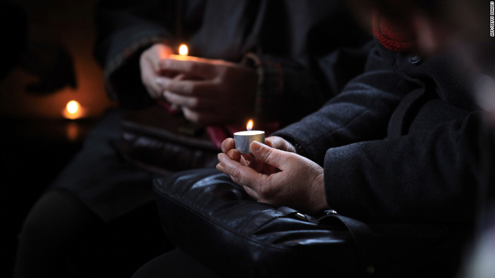 Candles are lit ahead of the 10th New Year's Eve peace vigil being held inside the 700-year-old St. Giles Church in the village of Imber in Salisbury Plain, England. The church, along with the rest of the village, was evacuated in December 1943 by the military for training U.S. soldiers preparing for the D-Day invasion, and villagers were told at the time they would be allowed to return in six months. But despite public appeals, the village remains in the control of the Ministry of Defense.