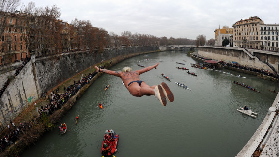 A reveler in Italy takes a celebratory dive into Rome's Tiber River as part of traditional New Year's celebrations on Sunday, January 1, 2012.