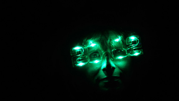 A concert-goer in  Las Vegas lights up 2012.