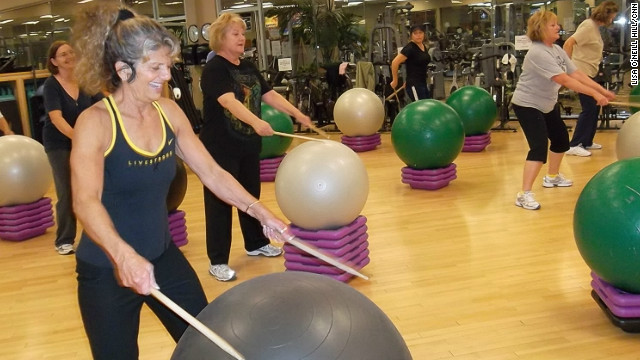 Instructor Janet Anderson leads a drumming class at Total Woman Gym and Day Spa in Placentia, California.