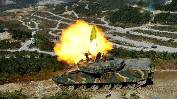A South Korean K-1 tank fires live rounds during a military exercise near the border with North Korea on September 30, 2011.
