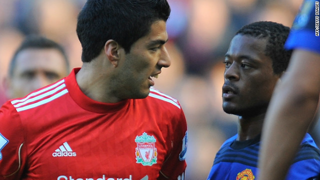 Luis Suarez and Patrice Evra exchange heated words during Liverpool's EPL game against Manchester United.