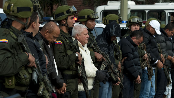 Police guard alleged members of the 'Loco Barrera' (Crazy Barrera) drug trafficking ring. The U.S. wants them extradited.