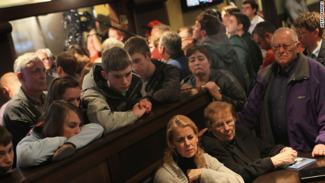 Guests in Marshalltown, Iowa watch a live C-SPAN broadcast as Rick Santorum speaks in an adjacent room at Legends Bar and Grill last week