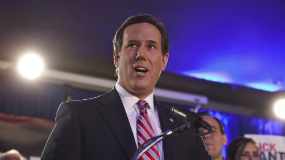 GOP presidential hopeful Rick Santorum addresses a crowd of supporters Tuesday night in Johnston, Iowa.