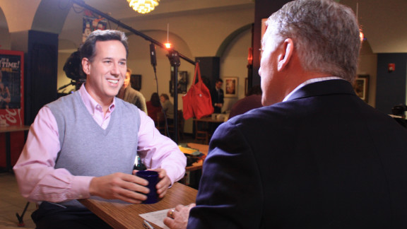 Most men can't pull off pink -- but Santorum isn't most men. Here he tones down the ensemble with a gray sweater vest to talk with CNN's John King in a diner in Cedar Rapids.