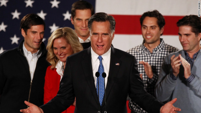 Mitt Romney speaks as his wife Ann Romney and their sons look on after the very close finish in the Iowa caucus.