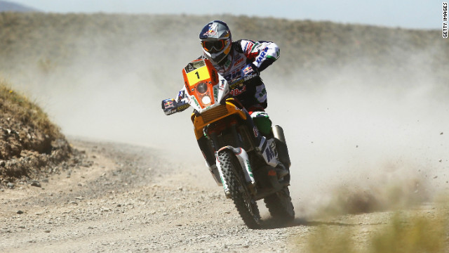 Defending champion Marc Coma won the fourth stage of the Dakar Rally but he trails leader Cyril Despres by over eight minutes.