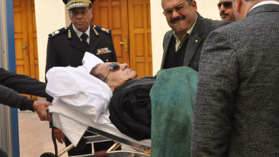 Ousted Egyptian president Hosni Mubarak is wheeled on a stretcher into the courtroom in Cairo on January 3, 2012.