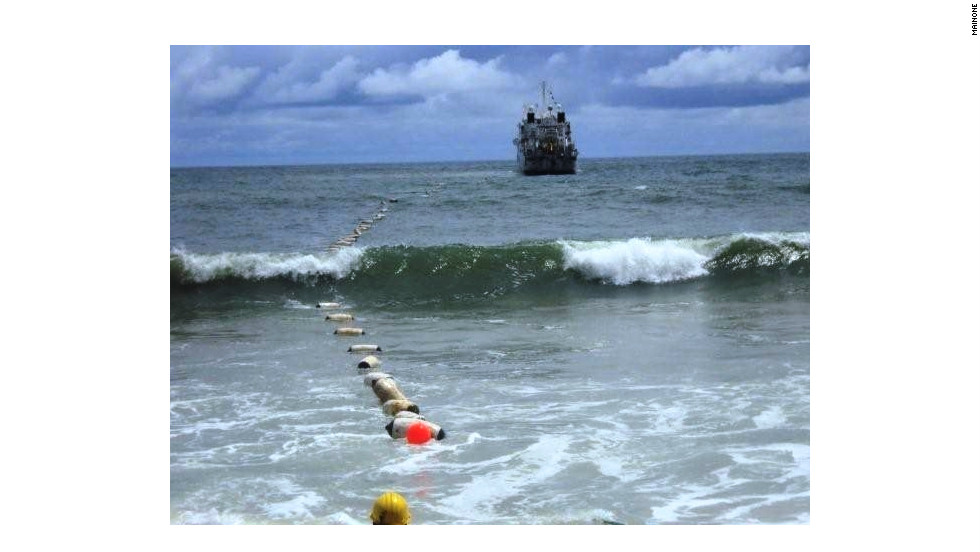 A  submarine fiber-optic cable emerges off the coast of Nigeria to help bridge the digital divide in the continent. Terrestrial connection methods such as this are more costly and cumbersome than satellite powered coverage.