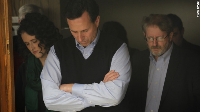 Rick Santorum bows his head in prayer during a campaign rally in Iowa this week.