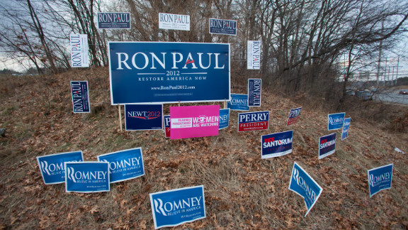 Political signs are seen on the roadside in Manchester, New Hampshire, on Thursday.