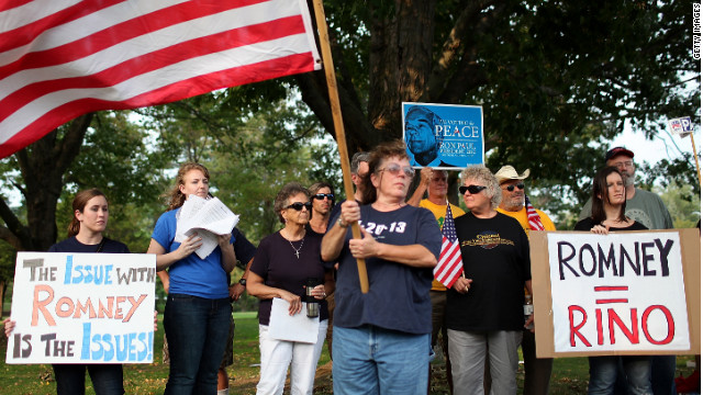 Members of the New Hampshire Tea Party protest against  Mitt Romney before a rally on September 4, 2011.