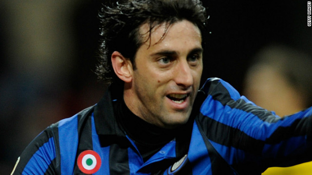 Diego Milito celebrates after scoring Inter Milan's first goal in the home romp against Parma at Stadio Giuseppe Meazza.