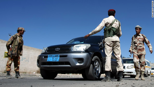 Defected Yemeni soldiers man a checkpoint to the square in Sanaa where anti-government protesters gathered Saturday.