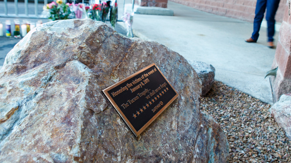 A commemorative plaque marks the site of the shooting at the La Toscana Village Safeway.
