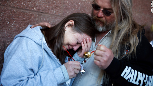Mourners attend a memorial service in Tucson, Arizona, on January 8, 20112, one year after a shooting left six dead.