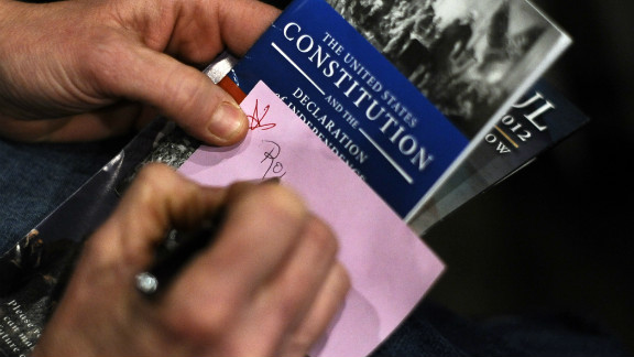 A voter writes his vote on a ballot during republican caucues at a school in Des Moines, Iowa, on January 3, 2012.