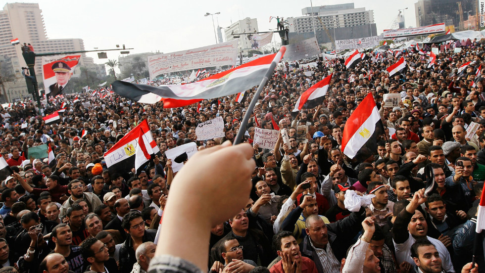 "Naga added his voice to the thousands of protesters in Tahrir Square calling for a regime change. ""There was a sense of a new spirit that came to Egyptians and they felt we are all equal and we are all fighting for the same rights,"" he said."