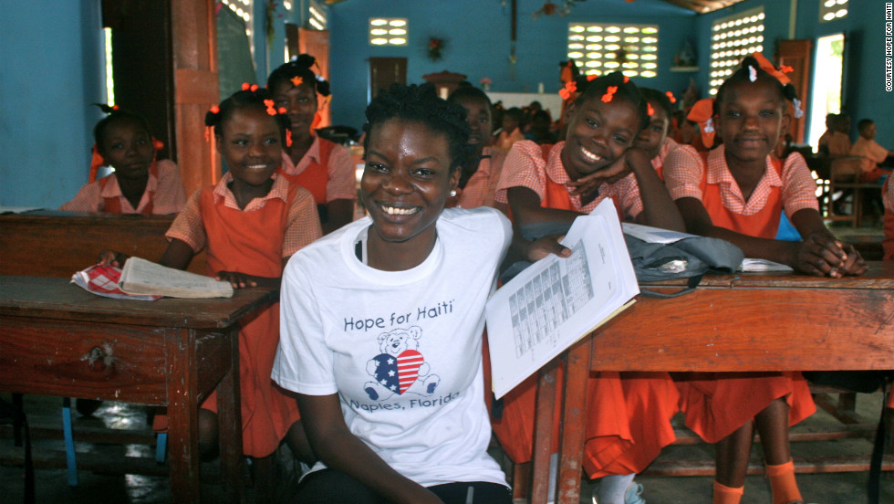 Jessica Jean-Francois, program manager for Hope for Haiti, meets students at the Notre Dame de Cherettes Primary School in Cherettes. Hope for Haiti supports 40 schools and 400 teachers in Haiti.