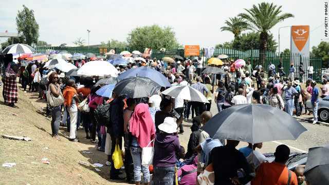 Students queue outside the University of Johannesburg to secure some of the last remaining university places on January 10, 2012.