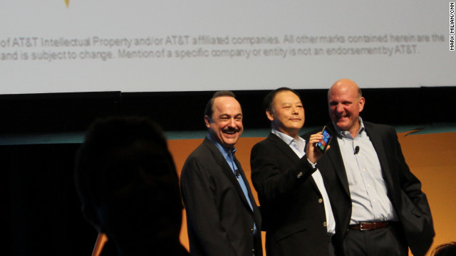 AT&T CEO Ralph de la Vega, from left, HTC CEO Peter Chou and Microsoft CEO Steve Ballmer promote Windows Phone products.
