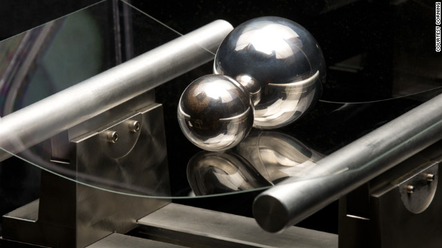 The new Corning glass supports two steel balls, showing its strength and flexibility.