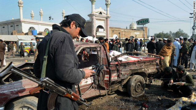 Pakistani security personnel examine the site of a bomb blast in the Jamrud Market in the Khyber Agency on January 10, 2012.
