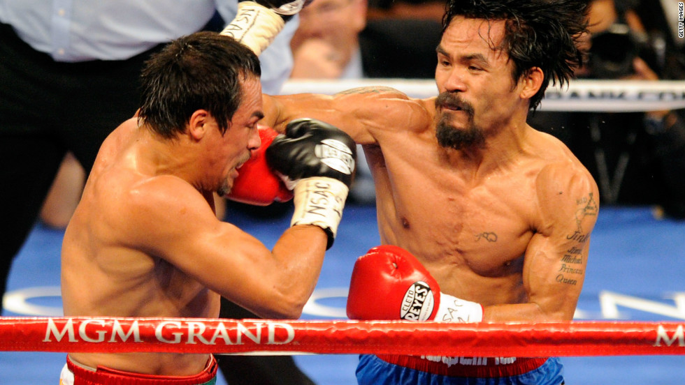 Manny Pacquiao (right) retained his WBO world welterweight title against Juan Manuel Marquez in Las Vegas, Nevada in November 2011. In May 2010, he was elected as a Sarangani representative in the Filipino Congress.