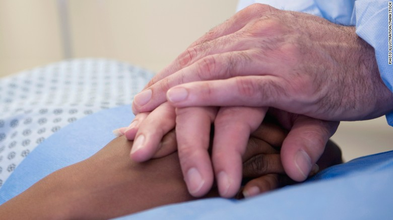 Dying Cancer Patients Holding Hands