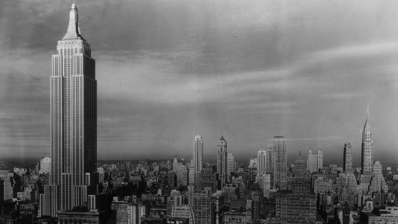 """New York's Empire State Building (L), circa 1938, was the world's tallest building for nearly 40 years. It was nicknamed the """"Empty State Building"""" as much of the building went unrented in its early years. In 1950, the now-iconic landmark finally started to turn a profit."""