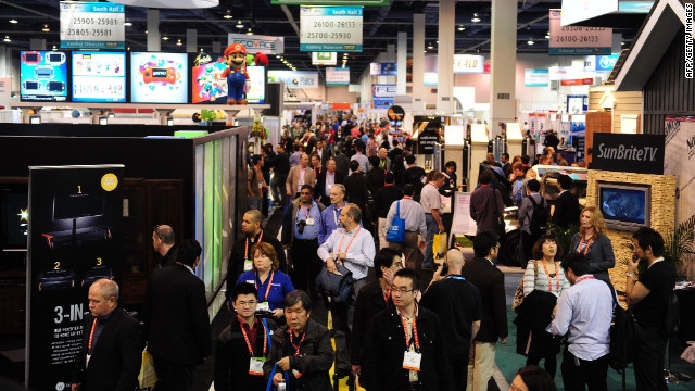 Visitors make their way between display booths at the International Consumer Electronics Show in Las Vegas, Nevada.