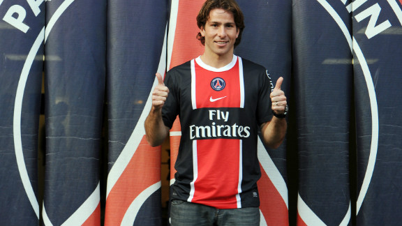 Maxwell parades in his new Paris St Germain kit after completing his signing from Barcelona.