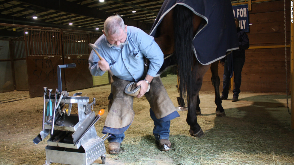 Del Slaugh puts a new set of horseshoes on a horse named West Indies. Slaugh has been a farrier for 43 years.