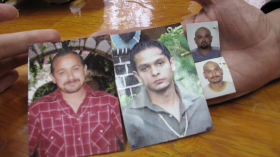 "Maria Herrera Magdalena holds photos of her four missing children: Salvador, Raul, Gustavo and Luis Armando. ""When I start to talk about my sons, I can"