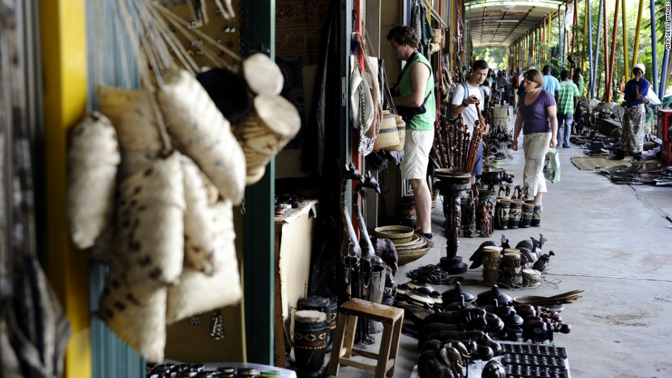 Tourists shop at a craft market in the nearby town of Livingstone, Zambia.