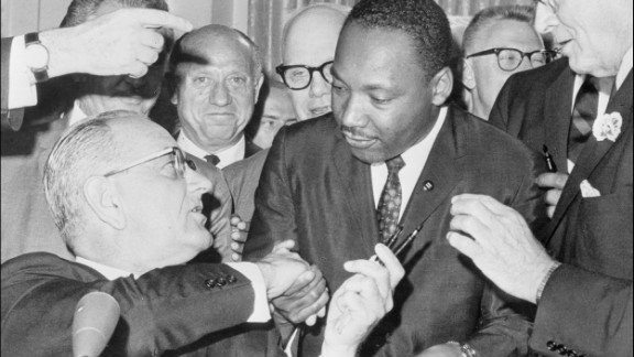 President Lyndon Johnson shakes hands with Martin Luther KIng Jr. after signing of the 1964 Civil Rights Act at the White House..