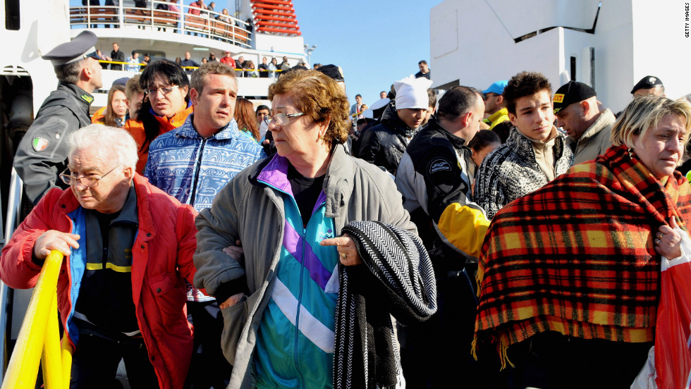 On January 14, crowds prepare to leave the island of Giglio, where passengers were staying after the ship ran aground.
