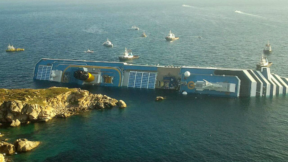 The huge ship, nearly the length of three football fields, was carrying about 3,200 passengers and 1,000 crew members when it rammed into a bed of rocks around 9:45 p.m.