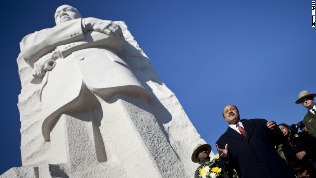 Martin Luther King III speaks at the base of a statue of his father after a wreath-laying ceremony Sunday in Washington.