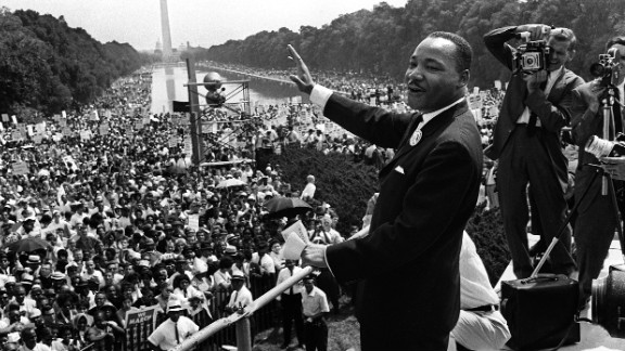 Dr. Martin Luther King Jr. waves to the throngs of people gathered in August 1963 during the March on Washington.