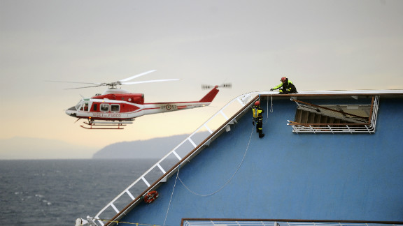 "Firemen work on the Costa Concordia cruise ship on January 16. The captain may have made ""significant"" errors that led to wreck, the cruise line said."
