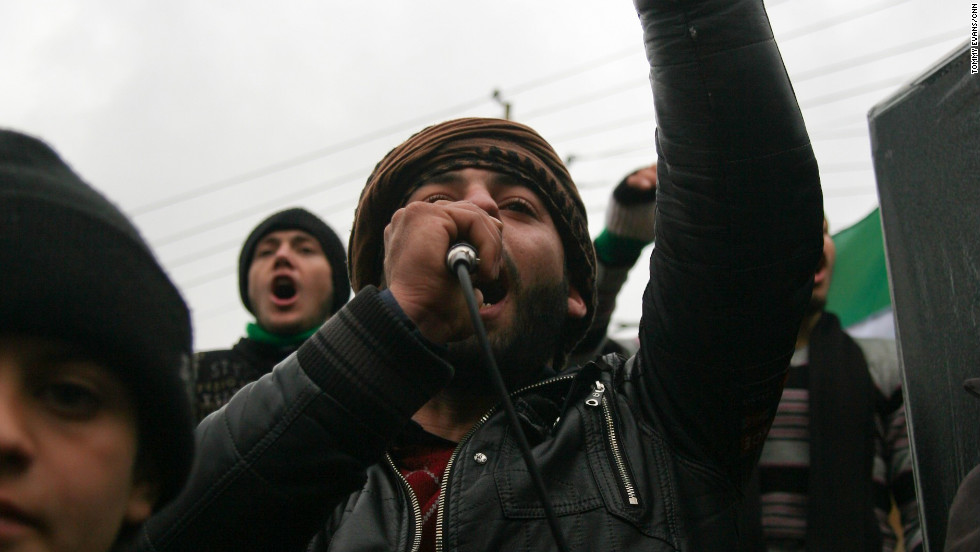 A protester leads the crowd in an anti-regime chant.